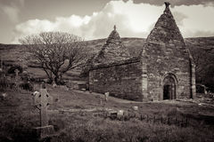 Kilmalkedar church. Dingle Peninsula. Ireland. Ruins of the romanesque church of Kilmalkedar. Dingle Peninsula. county Kerry. Ireland Royalty Free Stock Photos