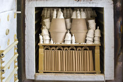 Kiln firing of ceramics. View of the kiln firing of ceramics and handmade pottery in a workshop Royalty Free Stock Photography