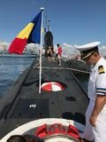 The Kilo-Class Submarine Delfinul. CONSTANTA, ROMANIA - AUGUST 11, 2018: Persons visiting the Romanian Naval Forces kilo-class submarine Delfinul, on the stock image