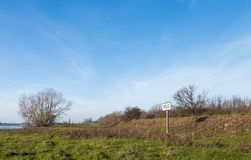 Kilometer marker along a wide river in Netherlands Royalty Free Stock Photo