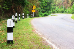 Kilometer post and curve road Royalty Free Stock Images