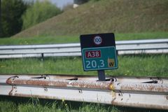 Kilometrage signs in green and speed sign on the black on the shortest highway in the Netherlands, the A38 with length of 2 km. Kilometrage signs in green and royalty free stock image