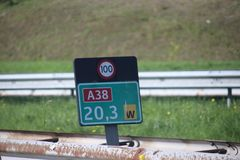 Kilometrage signs in green and speed sign on the black on the shortest highway in the Netherlands, the A38 with length of 2 km. Kilometrage signs in green and royalty free stock photo