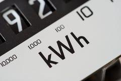 Kilowatt electric meter dial macro close-up. Electricity meter dial close-up and showing kilowatt hour stock images