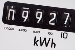 Kilowatt electric meter dial macro close-up. Electricity meter dial close-up and showing kilowatt hour royalty free stock photography