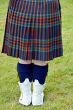 The kilt. Is a knee-length garment with pleats at the rear, originating in the traditional dress of men and boys in the Scottish Highlands of the 16th century Royalty Free Stock Image