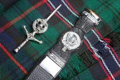 Kilt pin and scottish knife Stock Images