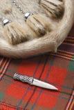Kilt pin and Sporran. Scottish clan kilt, kilt-pin and sporran Stock Image