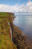 Kilt Rock and Waterfall, Skye, Scotland. This picture shows the famous Kilt Rock on the island of Skye, in Scotland. In the foreground there's a small waterfall Stock Image