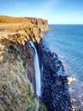 Kilt Rock Waterfall in winter midday. Kilt rock coastline cliff and waterfall in Scottish highlands Stock Photos