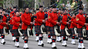 Kilted Bagpipe players marching Stock Photo