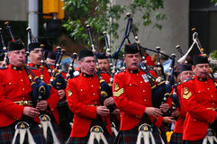 Kilted Bagpipe players marching Stock Photos