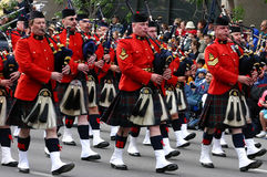 Kilted Bagpipe players marching Royalty Free Stock Photography