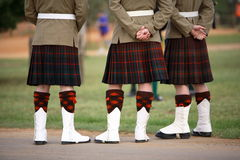 Kilts. Three Scottish solders dressed in kilts royalty free stock image