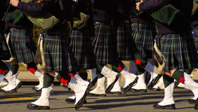Kilts de joueurs de pipeau Photo stock