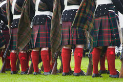 Kilts. Scottish traditional regiment with old rifles, wearing colourful tartan kilts, socks and flashes royalty free stock photos