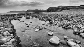 Kilve Beach. In Somerset with rock pools ad Jurassic cliffs Royalty Free Stock Photo