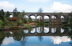 Kilver Court Gardens, Shepton Mallet, Somerset UK. Historic lakeside garden located beneath disused Victorian Charlton Viaduct