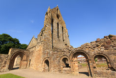 Kilwinning Abbey. The ruins of Kilwinning Abbey against a blue sky royalty free stock photo