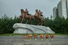 Kim Il Sung and Kim Jong Il on horseback Royalty Free Stock Photos