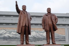 Kim Il Sung & Kim Jong Il. Statues of Kim Il Sung and Kim Jong Il at the Mansudae Grand Monument in Pyongyang Stock Images