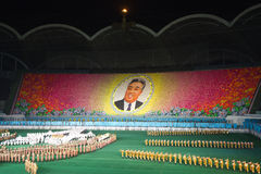 Kim Il Sung Portrait at Arirang Mass Games in DPRK. Tribune showing a portrait of Kim Il Sung, the founder of the DPRK. The tribune picture is formed by tens of Royalty Free Stock Images