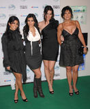 Kim Kardashian. (2nd from left) with her sisters & mother at nominations announcement party for the People's Choice Awards at Area Nightclub, West Hollywood Royalty Free Stock Photos