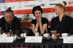 Kim Ki-Duk, Irina Apeximova, Maria Jarvenhelmi at press-conference. MOSCOW - APRIL 19, 2019: Left to right - Film director Kim Ki-Duk, South Korea, actress Irina royalty free stock photo