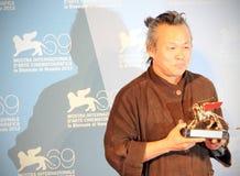 Kim Ki-Duk. Poses for photographers at 69th Venice Film Festival on September 8, 2012 in Venice, Italy Stock Photography