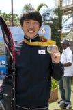 Kim vede Hyung con la medaglia di oro Immagini Stock