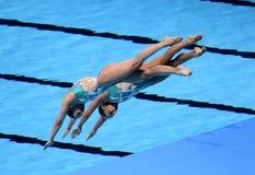 Kim Yuliya and Anastasiya Ruzmetova of Uzbekistan. During a Duet Synchronised Swimming event of World Championship BCN2013 on July 13, 2013 in Barcelona Spain Royalty Free Stock Image