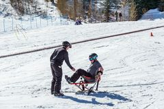 KIMBERLEY, CANADA - MARCH 19, 2019: handicapped person riding a mono ski Vancouver Adaptive Snow Sports. Active activity alpine athlete disability disabled royalty free stock photo