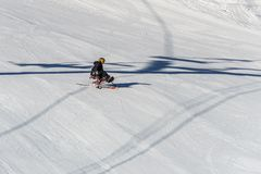 KIMBERLEY, CANADA - MARCH 22, 2019: handicapped person riding a sit-skis Vancouver Adaptive Snow Sports. Active, activity, alpine, athlete, disability stock image