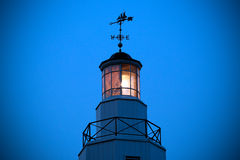 Kimberly Point Lighthouse Light with Weather Vane. This image features the Kimberly Point Lighthouse on Lake Winnebago, Wisconsin, U.S.A.  The lighthouse shines Royalty Free Stock Photography