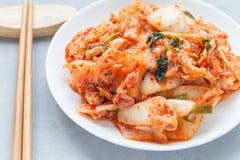 Kimchi cabbage. Korean appetizer on white plate, horizontal, closeup Stock Photo