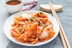Kimchi cabbage. Korean appetizer on white plate, horizontal Royalty Free Stock Photos