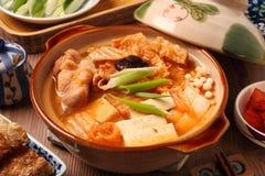 Kimchi hot pot. On the table stock image
