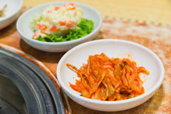 Kimchi korea food on the table. Beside  barbecue stove Royalty Free Stock Photos