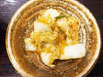 Kimchi, Korean traditional food. The food is made by fermenting red peppers and vegetables. In general, it is white cabbage. The taste is sour, spicy and Stock Photo