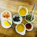 Kimchi, nori and radish traditional Korean fermented food in small bowls. Seoul, South Korea stock photography
