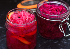 Kimchi-pickled vegetables in a jar. Kimchi- pickled onions,fermented and served with salads,sandwiches,burgers Royalty Free Stock Photography