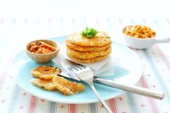Kimchi Potato Pancakes. Pan-fried potato pancakes that contain a mixture of mashed potatoes, kimchi, sweet corn kernels, cod flesh, small cubes of king trumpet ( Stock Photography