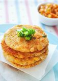 Kimchi Potato Pancakes. Pan-fried potato pancakes that contain a mixture of mashed potatoes, kimchi, sweet corn kernels, cod flesh, small cubes of king trumpet ( Royalty Free Stock Photo