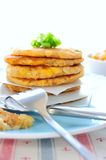 Kimchi Potato Pancakes. Pan-fried potato pancakes that contain a mixture of mashed potatoes, kimchi, sweet corn kernels, cod flesh, small cubes of king trumpet ( Stock Photo