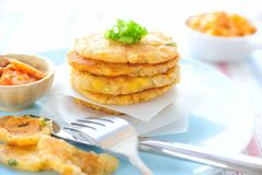Kimchi Potato Pancakes. Pan-fried potato pancakes that contain a mixture of mashed potatoes, kimchi, sweet corn kernels, cod flesh, small cubes of king trumpet ( Stock Photos