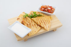 Kimchi quesadilla. Cheddar cheese quesadilla's with guacamole fresh salsa and sliced red chili pepper topped with guacamole and cilantro Stock Image