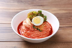 Kimchi spaghetti noodle with boiled egg and salad Royalty Free Stock Image