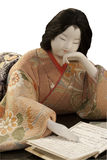 Kimehomi ningyo doll. A japanese doll of a woman reading a book Stock Photo