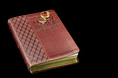 Kimg James Bible with Gold Wedding Rings isolated on Black Royalty Free Stock Photo