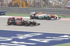 Kimi Raikkonen Лотос-Renault настигая усилие  Стоковое фото RF